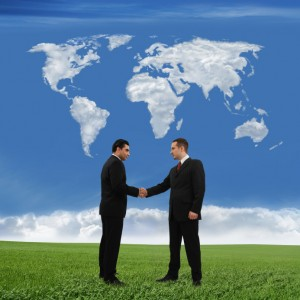 Handshake with World Map and Grass iStock_000006371021_Small
